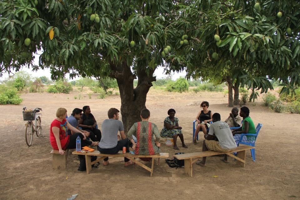 Meeting in Orbili village on the border of Burkina Faso regarding the impact of pest infestation on dry season vegetable crops.