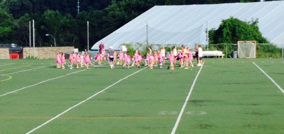 Little Laxers learning fun stick tricks at the Tucker Lacrosse camp, July 2015.